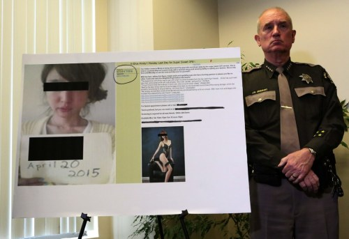 King County Sheriff John Urquhart at a news conference where criminal charges are announced Thurs., Jan. 7, 2016, in Seattle against the operators of an online review board where men can view prostitution ads and post reviews about their sexual experiences with women involved in prostitution. Law enforcement said this display shows a victim from Korea. (Ken Lambert / The Seattle Times)