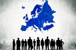 Group Of Business People Standing In A White Background With Blue Europe Cartography Above